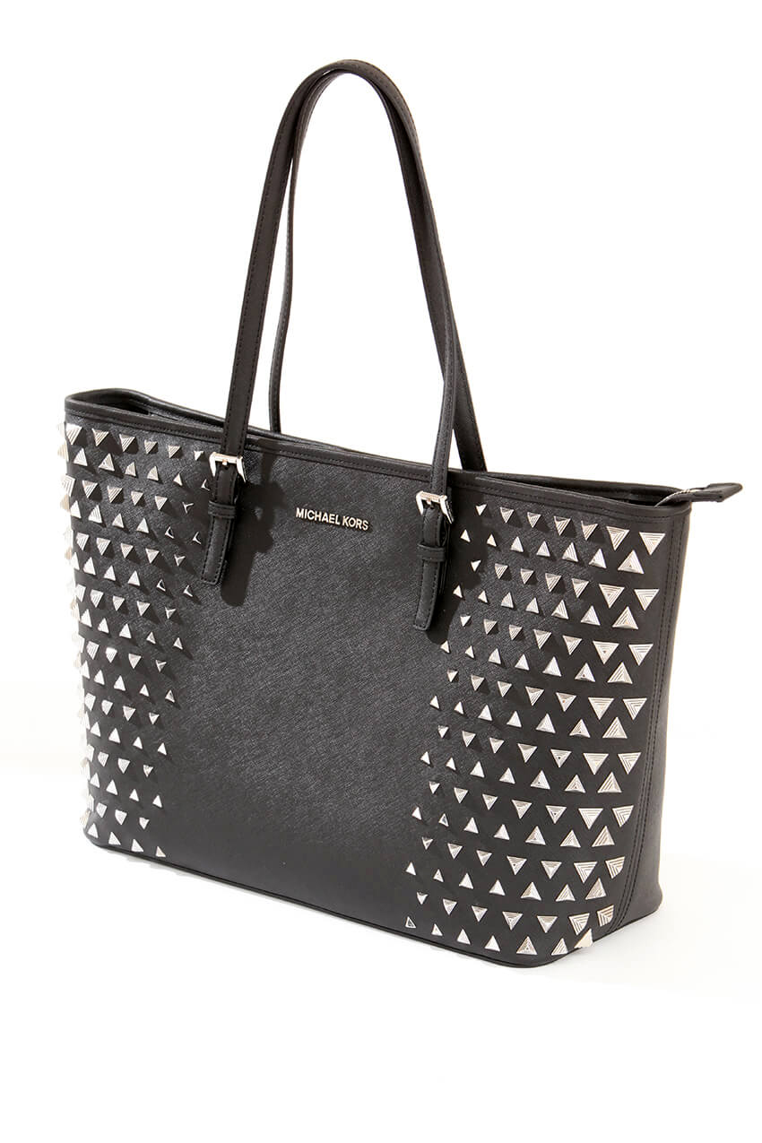 A studio product image of a Michael Coors studded black handbag taken in Rotherham